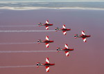 PC-9s from the Royal Australian Air Force aerobatic team, the Roulettes, fly in formation oer Lake Eyre on the way to Coober Pedy on 1 November 2010. (RAAF)