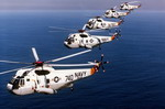 Five SH-3 Sea King anti-submarine warfare helicopters from Helicopter Anti-submarine Squadron 12 (HS-12) of the US Navy flying in formation in 1995. (DoD)