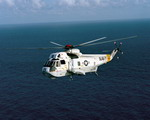 An SH-3G Sea King from Fleet Composite Squadron 8 (VC-8) from Naval Air Station Roosevelt Roads, Puerto Rico, over the ocean on 9 April 1983. (USN/Lt Bob Struth)