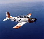 A Beech T-34 Mentor from the US Navy's Training Squadron 5 (VT-5) flies above the ocean on 3 November 1976. (USN/PHCS R L Lawson)