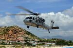 An MH-60 Seahawk from Helicopter Sea Combat Squadron 28 based on the USS Kearsarge lands in Haiti as part of the UN's hurricane relief efforts in September 2008. (USN/Mass Communication Specialist 3rd Class William S Parker)
