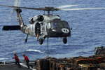 A Sikorsky MH-60S Sea Hawk from HSC-8 airlifts supplies on 16 June 2009 in the Gulf of Alaska during exercise Northern Edge 09. (USN/Mass Communications Specialist 3rd Class Kenneth Abbate)
