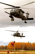 Two US Air Force HH-60G Pave Hawk helicopters from the 210th Rescue Squadron take part in an Arctic search and rescue exercise at Eilson AFB in Alaska on 13 September 2005. (USAF/ Staff Sgt Joshua Strang)