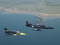 A Gnat making an interesting comparison next to a Hawker Hunter